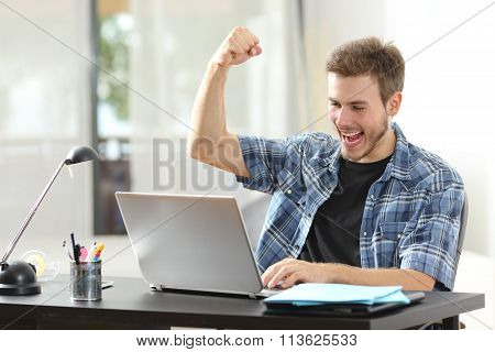 Euphoric Winner Man Using A Laptop At Home