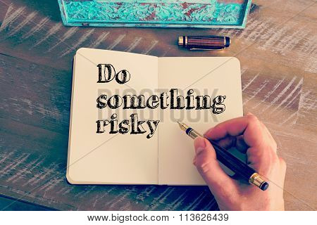 Motivational Message Do Something Risky Written On Notebook