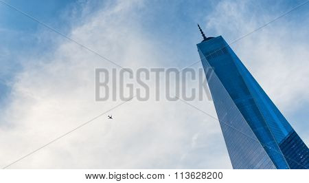 NEW YORK - SEPTEMBER 06: Plane overhead the One World Trade Center, Manhattan , New York built at Ground Zero to replace the Twin Towers destroyed in the terror attack. September 06, 2015 in New York.