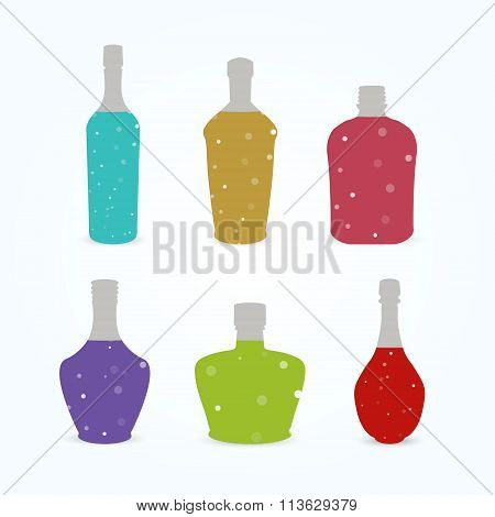 Different Bottles With Colorful Sparkling Liquid