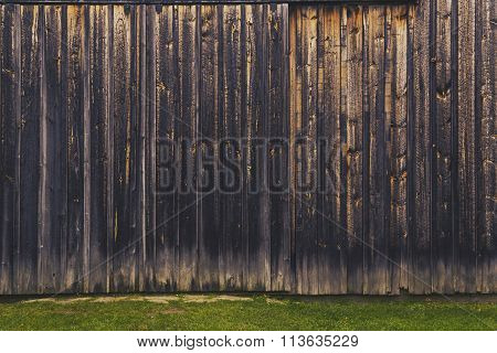 simple background of barn boards and grass