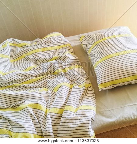 Messy Bed In Morning Sunlight