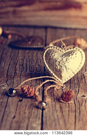 Silver heart on a wooden table with decorations. Valentines day. Love. Gift