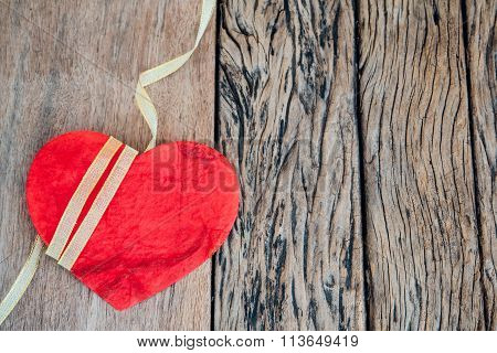 Red heart on wooden background. Valentine or wedding background.