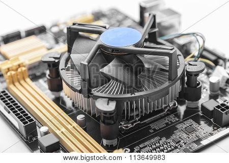 Computer motherboard on white.