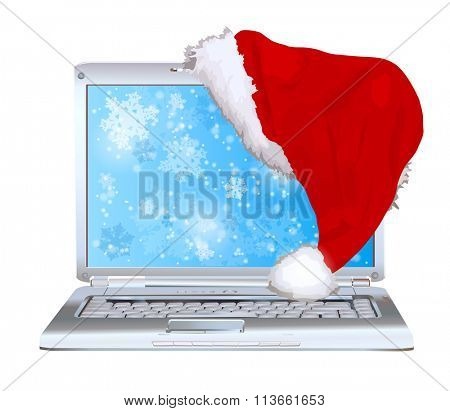 Silver laptop with santa hat new year concept