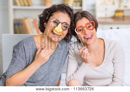 Two cheerful sisters enjoying themselves.