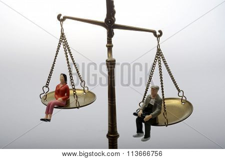 Man And Woman Sitting On Golden Weighing Scale