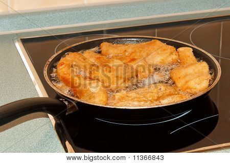 Delicious carp fillets roasted in the frying pan poster