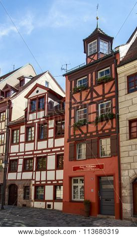 NUREMBERG, GERMANY - AUGUST 23, 2015: The Weißgerbergasse (Tanners' Lane) is a famous street in Nuremberg with around 20 half-timbered houses and is the historical area of the old craftsman quarter