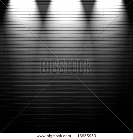 metal fence with spotlight background