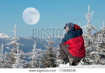photographer photographing winter panorama in high mountains