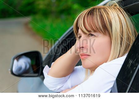 The Face Of A Mature Woman Driver In Car