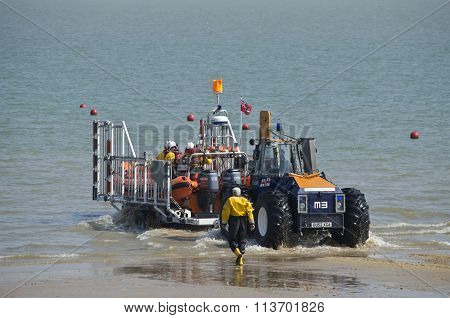 Tractor launching a lifeboat