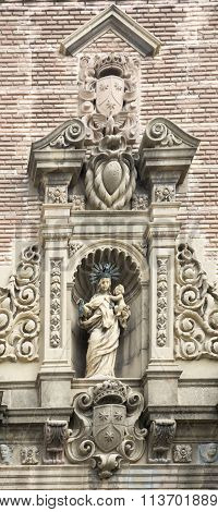 Statue In The Niches Flanking The Building