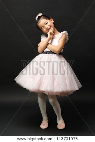 Asian child wearing a pretty dress