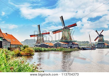 Unique old authentic real working windmills in the suburbs of Amsterdam the Netherlands. poster
