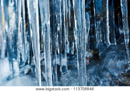 Icicles Hanging On Mountain Rock
