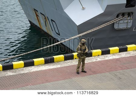 Odesa, UKRAINE - MARCH, 26, 2015: Soldiers  in full gear patrol the area at port during visit of Fre