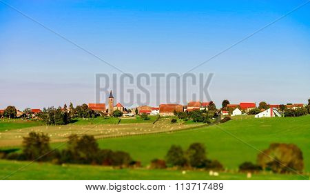 Beautiful Village Landscape With Green Pasturage