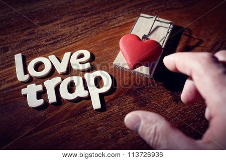 Mousetrap with heart concept for love trap, affair, temptation, heartbreak and flirting