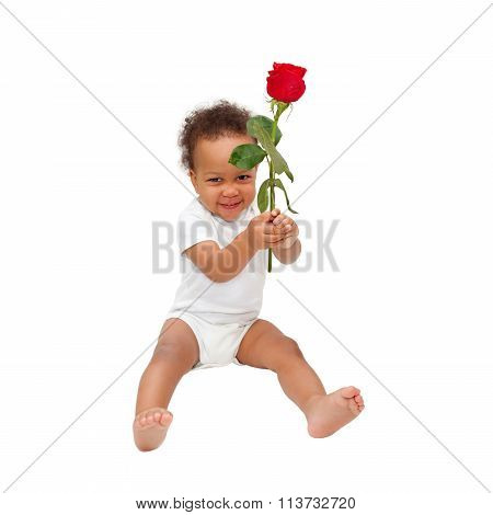 Smiling Black Baby Gives A Flower.