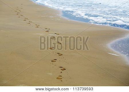 Feet Prints On Sea Beach