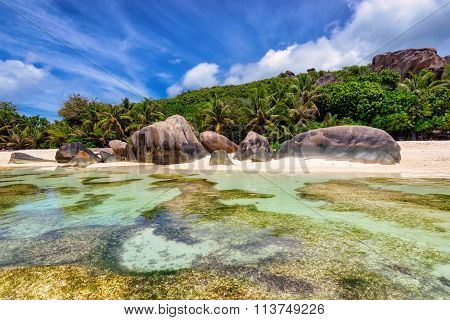 Granite rocks at beach on island La Digue in Seychelles