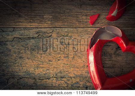 Valentine Broken Heart On A Wooden Background