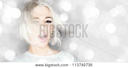 Beautiful Woman Platinum Blonde Posing On The Sparkling Background