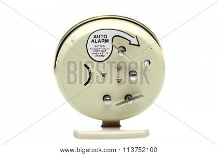 The back of a 1950's era Alarm Clock isolated on white, with room for text.