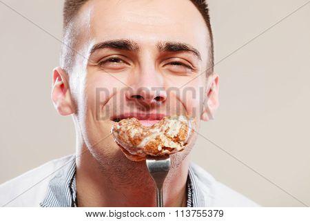 Smiling Man Eating Cake.