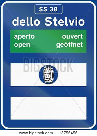 Road Sign Used In Italy - Road Conditions To Dello Stelvio, With The Word Open In Different Language