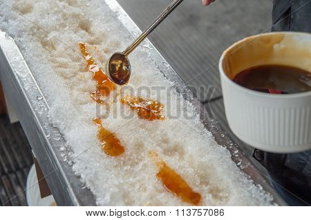 Maple Taffy On Snow During Sugar Shack Period. In Quebec, Canada.