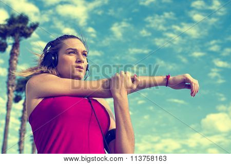 Young Blonde Woman Stretching While Listening To Music