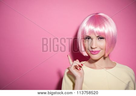 Cheerful young woman is presenting something proudly