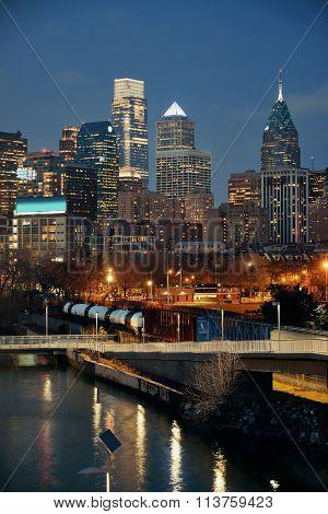 Philadelphia skyline at night with urban architecture.