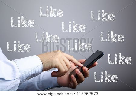 Businessman Use Smart Phone With Like Text