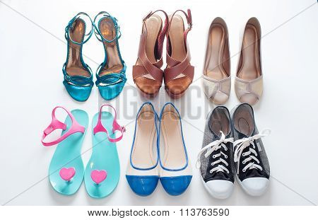 ladies shoes on wooden background