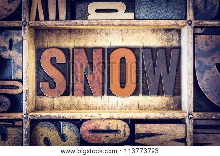 "The word ""Snow"" written in vintage wooden letterpress type. poster"