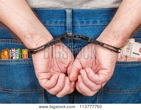 Arrested Male In Handcuffs Behind Her Back With Credit Cards And Money In The Back Jeans Pocket