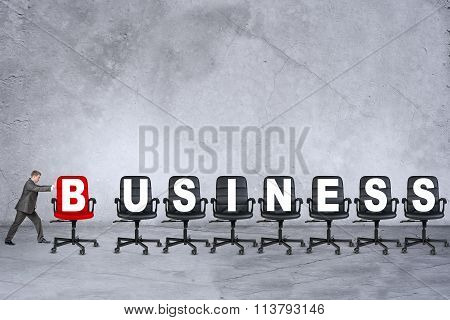 Young businessman pushing word business