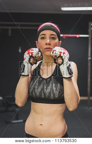 Portrait Of A Beautiful Girl With Boxing Gloves