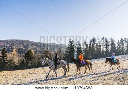 Three Girls Go Horseback Riding.