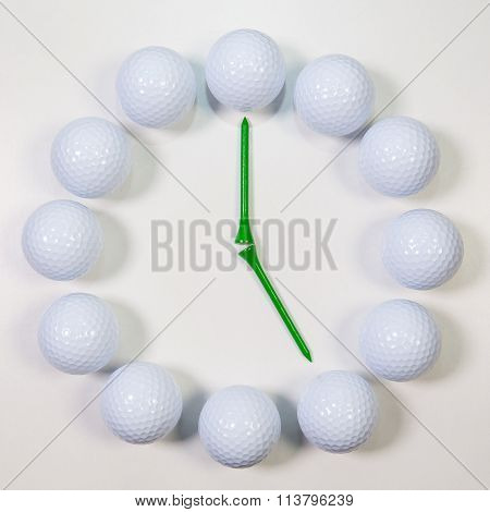 The Clock Of Golf Balls And Wooden Tees