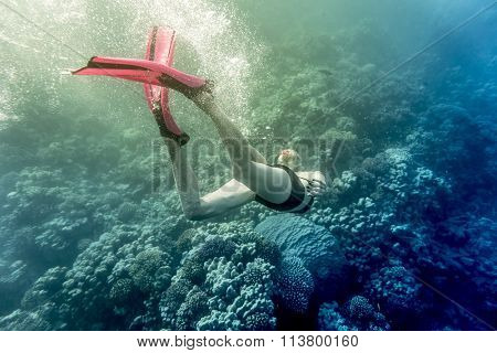 young woman snorkling under water