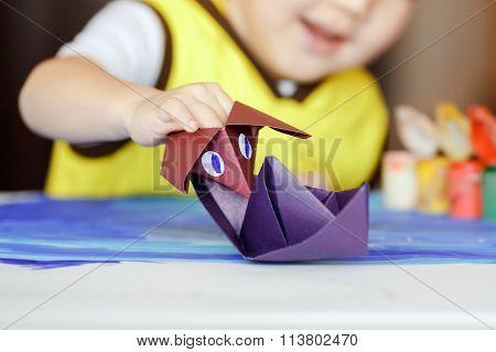 Fake battle, an origami figure Godzilla attacks a boat, children's games. The development of imagina