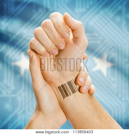 Barcode Id Number On Wrist And National Flag On Background - Micronesia