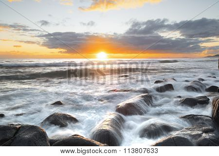 Sunrise over the ocean, on the rocks at Burleigh Heads