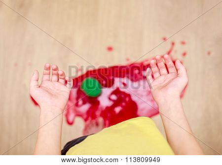 child dropped a jar of jam on the floor